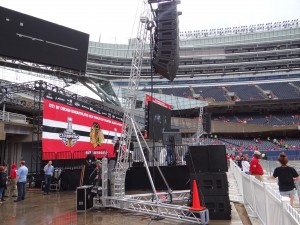Setting up for the rally at Soldier Field